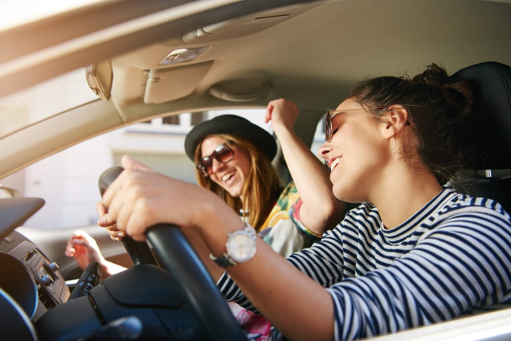 girls singing whilst driving to festival