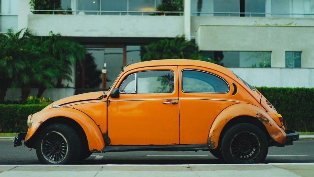An orange car with a grey background