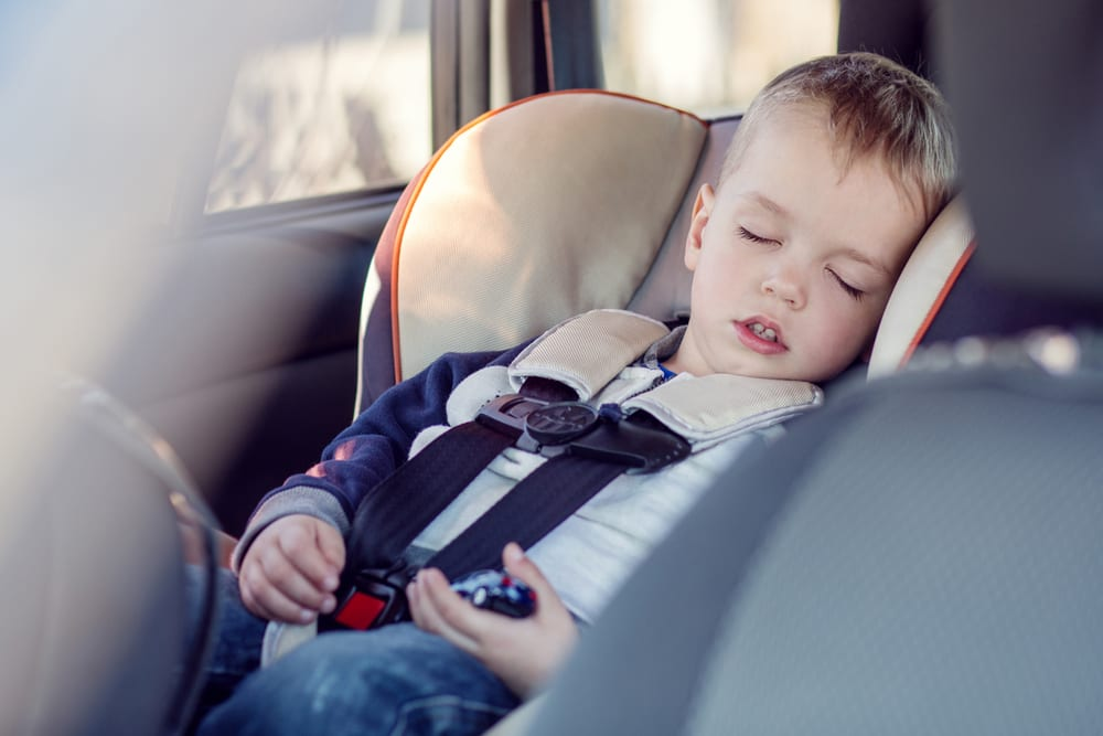 Child fast asleep in car
