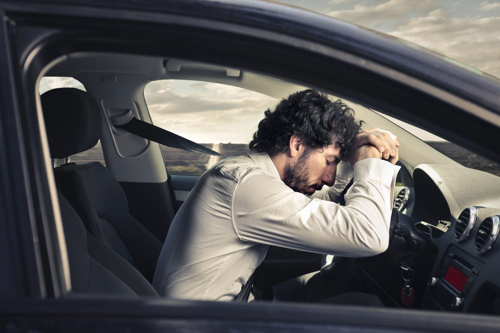 Tired driver in car