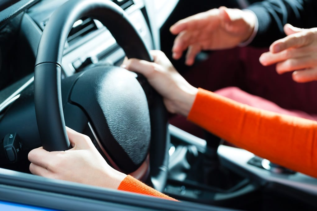 A girl holding the steering wheel