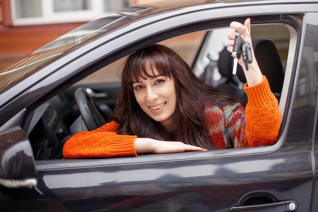 A girl holding her car keys after passing her test