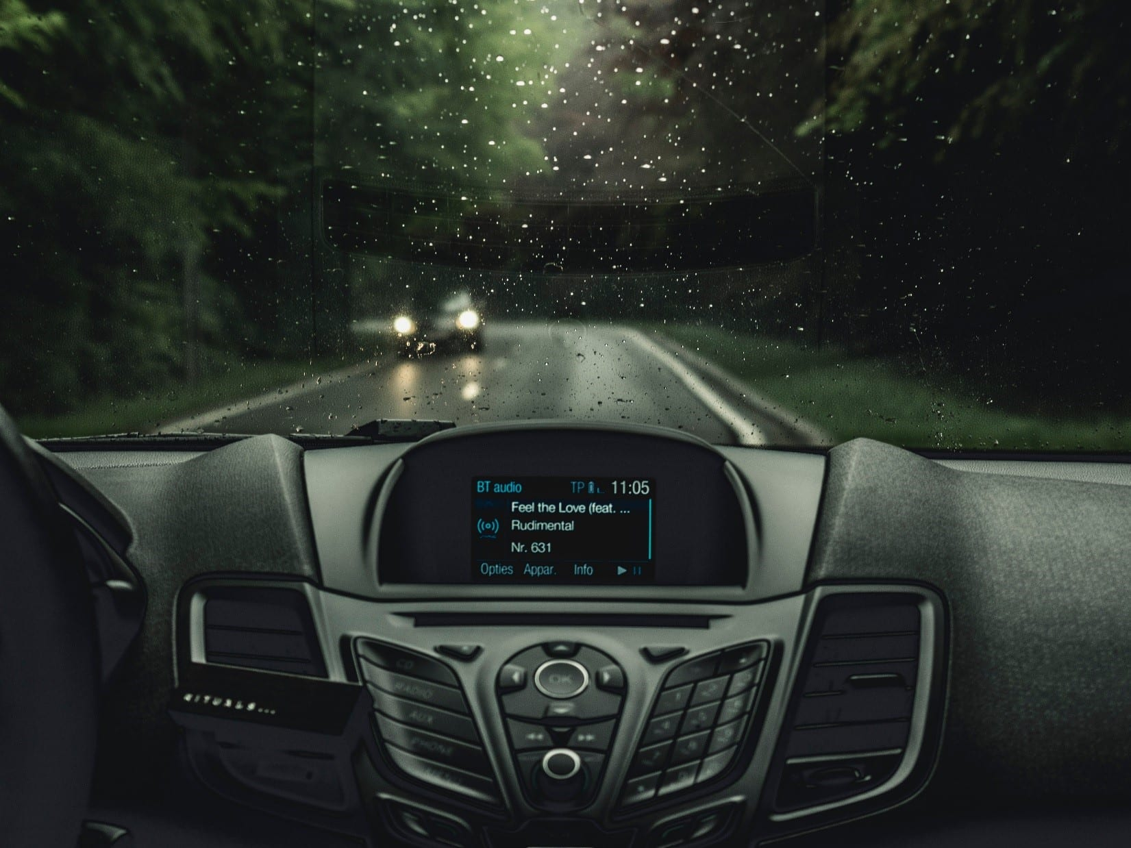 The car dashboard playing a song