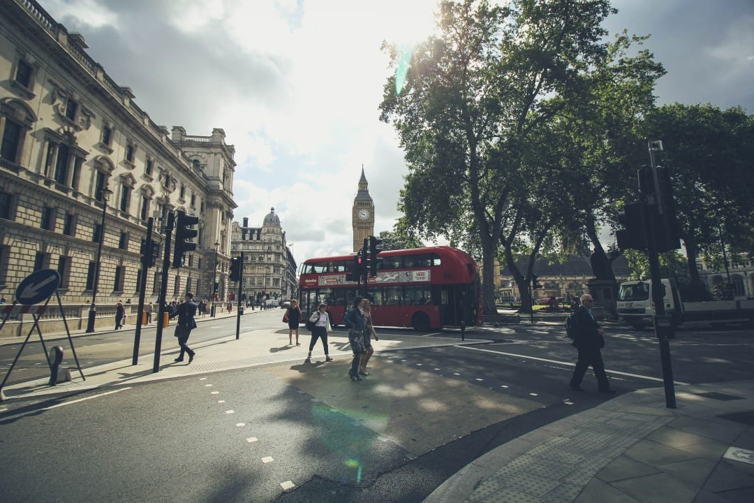 A pedestrian and cars in London