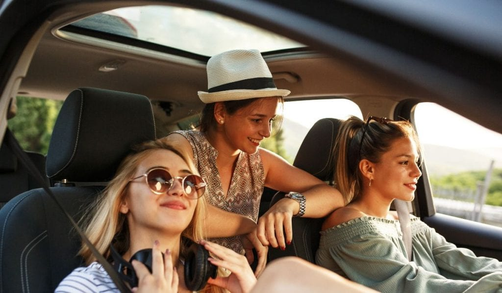 Students on road trip in car