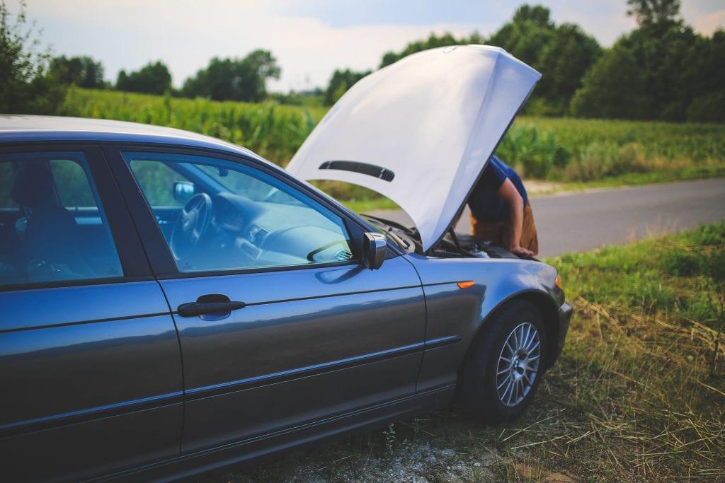 Repairing car on roadside