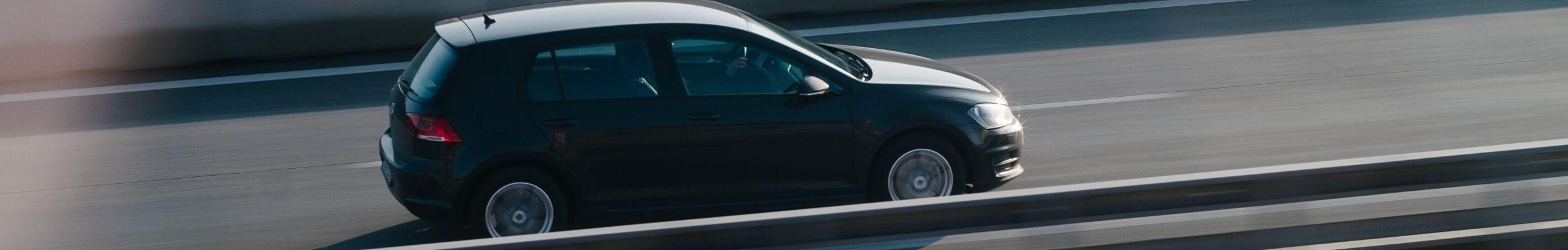 Car driving down motorway