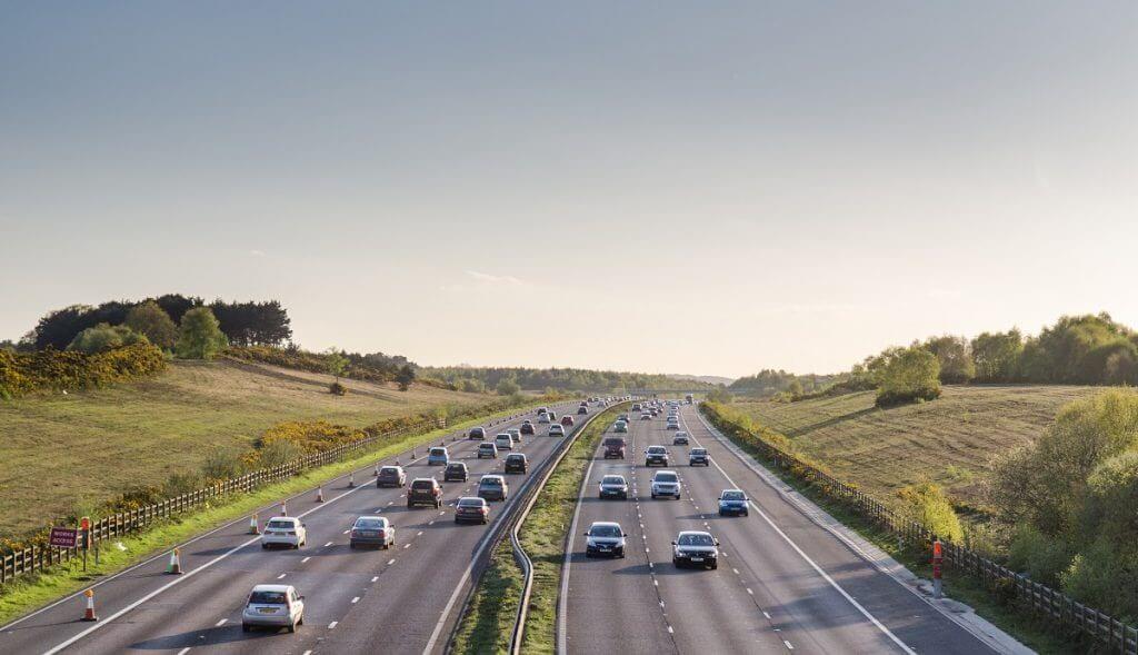 Cars driving down motorway